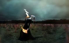 manipulation cg digital art photography occult witch dark fire flames fan dance ritual mood emotion situation fantasy gown dress gothic pale nature landscapes fields grass trees sky clouds storm wallpaper background