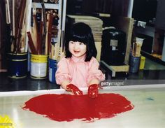 In this Handout Photo released on December 1, 2005 by the Imperial Household Agency, Japan's Princess Aiko, who celebrates her 4th birthday today, enjoys finger painting at National Children's Castle on November 30, 2005 in Tokyo, Japan.