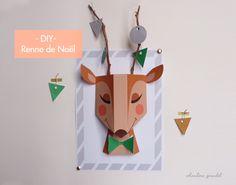 Prêt pour un DIY ? Pour votre décorationde Noël, je vous propose de  réaliser cette tête de renne en papier et de luiajouter de vraies branches  pour réaliser ses bois. Vous pourrez ainsi transformer ce renne en petit  sapin de Noël. On écoute l'album A veryShe & Him christmaspour se mettre  dans l'ambiance et c'est parti ! ;)  Pour ce DIY, vous avez besoin:  - d'imprimer ces 3pages (page 01 / page 02/ page 03)pour construire le  renne, les décorations et le cadre en papier(je ...