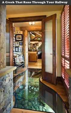 A log home built around a creek that ran right through the home building site. Solution: A glass floor - This is exactly the type of decor I want for my future house as well. This is amazing!