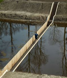 The sunken Moses Bridge is designed by RO-AD Architects. It is located at Fort de Roovere in the Netherlands.