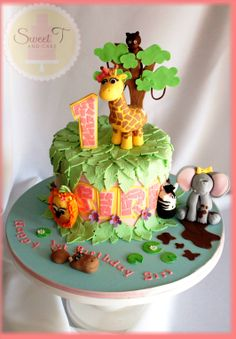 Jungle Cake by Teeny82 (Sweet T and Cake) on Cake Central. I LOVE how the palm leaves cover the top and the animals are just adorable.