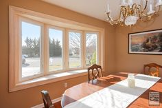 We installed this large, wood-trimmed bay window in this pretty dining room in Suffolk County... Home Renovations / Home Improvement / Home Remodeling / Bay Window from Renewal by Andersen Long Island