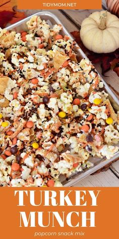TURKEY MUNCH - Fall Popcorn Snack Mix with bugles, Reese's pieces and sprinkles all drizzled in white chocolate and pumpkin candy melts. Full of fall flavor and color, and comes together in just 10 minutes, perfect for parties or gifts. PRINTABLE RECIPE at Tidymom.net