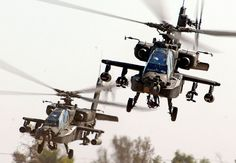 An air weapons team of two AH-64D Apaches from the 1st Battalion, 227th Aviation Regiment, 1st Air Cavalry Brigade, 1st Cavalry Division, come in for a landing at Camp Taji, Iraq, after completing a reconnaissance mission in the skies over Baghdad Nov. 6, 2007. Photo by Chief Warrant Officer 4 Daniel McClinton, 1st ACB, 1st Cav. Div., www.army.mil.    For more information about Apaches, visit: http://www.army.mil/factfiles/equipment/aircraft/apache.html. #ArmyAviation