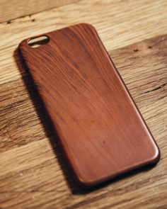 Snap on wood grain case for iPhone 6 or 6s. It snaps right on and is made of a polycarbonate material so it has some give to it.