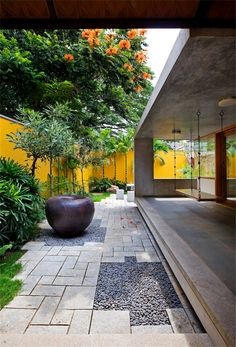 khosla associates / library house, bangalore I like the gravel filled open spaces in the pavers. Nice accent with the pot.