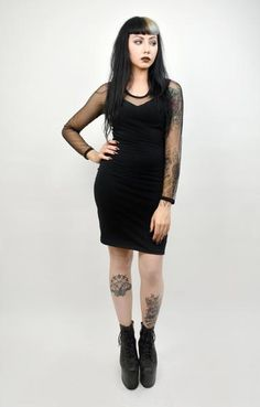 "The slimming fitted ""little black dress"" essential, but add the mesh neckline and sleeves and somehow, even by adding MORE coverage, you've got MORE sexiness! Behold! The magic of mesh! Long Sleeve Mesh Dress! Professionally sewn."
