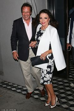 Happy couple; Joan Collins, 82, looked as smitten as ever as she stepped out with her husb...