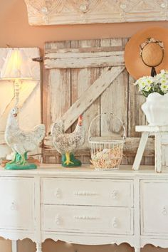 My vintage yard chickens…a flea market find...made themselves right at home in front of my new/old 'n' chippy hayloft barn door… (Sugar Pie Farmhouse)