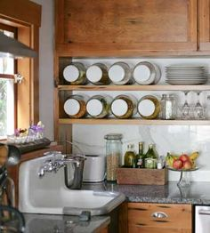 Old deli jars make great canisters -- turn them on their side and you can put 'em on open shelves, to see what you've got at a glance, without taking up counter space.