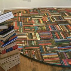 Rug made with recycled book spines. Pretty cool :)