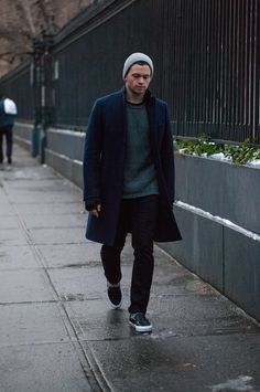 Cale Yancey, my kind of sunday stroll attire, vans slip-ons, slacks and a long coat. Beanie hat as standard, sweater optional.