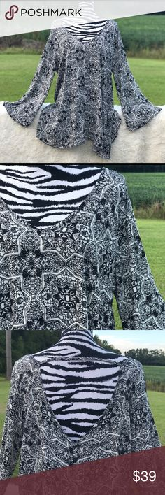 """Living Doll Plus Size Sheer Flare Sleeve Top Black and white Flare bell sleeve Sheer top. Low back with string across upper back. Flowy and light weight. Like new condition. Chest: 26"""" across laid flat. Length: 32"""" Living Doll Tops"""