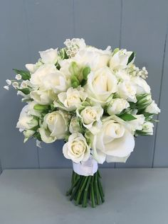 A classic bouquet with roses, freesia and lily of the valley. Lily Of The Valley, White Roses, Wedding Bouquets, Classic, Summer, Decor, Derby, Summer Time, Decoration