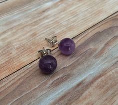 A personal favorite from my Etsy shop https://www.etsy.com/ca/listing/228550876/amethyst-simple-stud-earrings-february