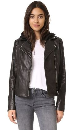 A leather Mackage moto jacket, updated with a removable, hooded dickey. Zips close the layered placket, 2 pockets, and cuffs. Long sleeves. Lined.