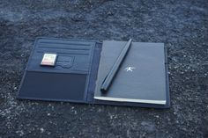 Tusked Crescent's leather Notepad & Passport Holder I ships with Tusked Crescent Black pad $30.  Features: ID display Slots for SD card Slots for three cards Pocket for notes or passport Pad slot (ships with pad) Penholder SIM card slot  Recommended with Fisher's compact Stowaway pen with clip $11.50  Extra pads $2  Clever Use Wins!