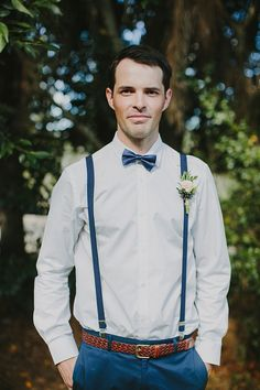 classic bow tie and suspenders, photo by Bek Grace http://ruffledblog.com/gold-coast-backyard-wedding #grooms