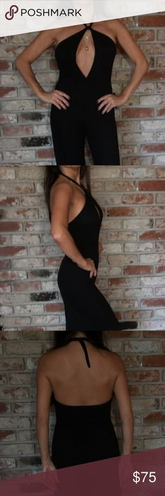 Atid black jumpsuit Hot black jumpsuit with amazing cleavage.  Fitted top with flare bottoms.  So crazy hot for a night out or a tasty date! Full on double take! Gotta have it! Atid Clothing Pants Jumpsuits & Rompers