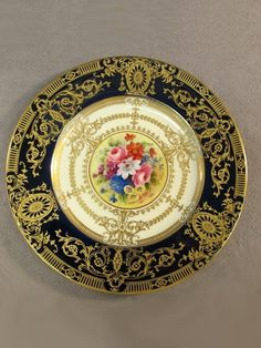 Royal Worcester, Mappin & Webb plate, central floral decoration hand painted by Horace H. Price and signed H H Price.