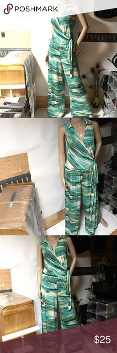 """🌊CREAM & GREEN POLY STRETCH JUMPSUIT FAUX WRAP 🌊CREAM & GREEN POLY STRETCH JUMPSUIT FAUX WRAP. VERY ADJUSTABLE INSEAM 30-34"""" DEPENDING UPON ADJUSTMENT OF FAUX WRAP. THIS IS A VINTAGE SUIT WITH NO SNAGS HOLES RIPS OR STAINS. VERY STRETCHY FITS 8-10 BEST. Vintage Pants Jumpsuits & Rompers"""