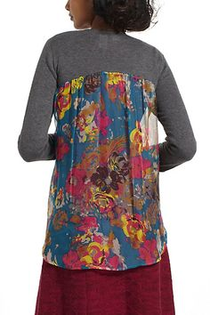 I'm totally going to cut an old cardigan and switch the fabric in the back like this one....