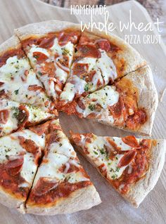 This Homemade Whole Wheat Pizza Crust is my family's favorite: it has a great nutty flavor, and bakes up soft and chewy - better than anythi... @Kitchen Meets Girl