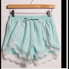 🎉SALE  🎉 Mint Lace trim shorts Super cute lace trim shorts. Mint. S(2-4) M(6-8) Fits true to size. M1150101  Model is a 2/4 wearing size small in above photo.  Only mint left in small or medium!!!! 2 a T Boutique  Other