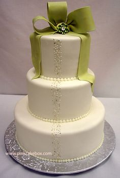 The vertical piped pearl design for the wedding cakes below works well for brides looking for elegant yet simple cake designs that can complement their Bow Wedding Cakes, Wedding Cake Decorations, Elegant Wedding Cakes, Wedding Cake Designs, Wedding Ideas, Wedding Stuff, Wedding Pictures, Pretty Cakes, Beautiful Cakes