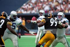 Quarterback Warren Moon of the Seattle Seahawks passes as offensive linemen Howard Ballard #75 and Brian Habib #68 block against linebackers Jason Gildon #92 and Levon Kirkland #99 of the Pittsburgh Steelers during a game at Three Rivers Stadium on September 27, 1998 in Pittsburgh, Pennsylvania.