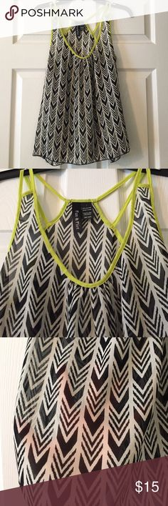 [fun & flirt] chevron top Black and white chevron with neon yellow edging. Slightly see thru (see third pic). Looks great with black shorts. Tops Tank Tops
