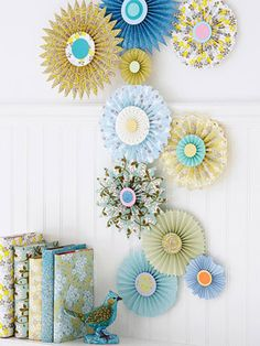 Paper Wall Medallions Create gorgeous pleated paper medallions that look like big blooms. Arrange different-size medallions into a collage. For additional decoration, wrap books in the springy papers.