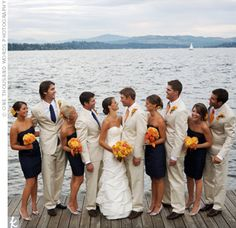 Navy blue, orange and yellow. Except the groom and groomsmen in a darker suit, with navy ties.