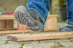 A worker with safety boots steps on a rusty nail. Man with safety boots steps on , Boot Quotes, Safety Quotes, Good Work Boots, Safety Training, Workplace Safety, Safety First, Illustrations, Stock Photos, Image