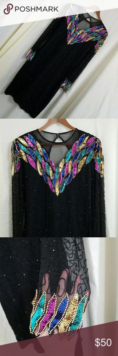 Vintage Silk beaded gown black rainbow sequin long Vintage Silk Lawrence Kazar beaded gown. Black with metallic gold and black beading. Bright rainbow sequin feather shaped collar in green, blue, pink and gold. Long sleeve. Sleeves are sheer and accented with the rainbow sequin design at the cuffs. Sheer v-neck. Keyhole back with zipper. Shoulderpads.  There are areas of loose beading, particularly on the back, but it's not really noticeable.  100% silk shell, poly lining. Size medium  Pit…