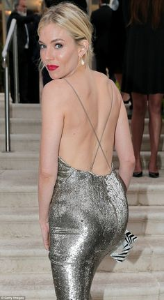 Sienna Miller booty in a backless silver gown