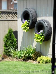 unique garden pots. Think this might be nicer if the tyres were painted a different colour.  Black would absorb so much heat they would dry out the roots in no time!