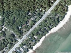 For sale: $13,000. Lake Huron is right across the street, with views from the property. This property includes deeded outlots on Lake Huron...Property sits between the Singing Bridge & Huron Breeze Golf Courses. Gas and electric on property, and capped. Water and sewer at street. Original well on property too. Land Contract Terms Available.