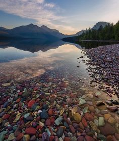 Vibrant colored rocks at Lake McDonald in Glacier National Park, Montana.   - Photo by: @dustinwongphotography 💦