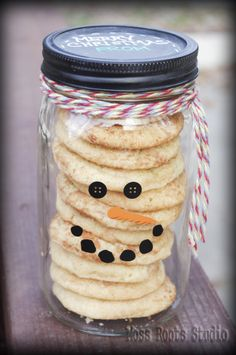 Gifts in a Jar - Jar of cookies... would be cute with those powdered sugar cookies...  Cute Jar with removable vinyl sticker face and chalkboard lid.