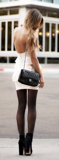 Loving the white backless dress with stockings and boots. Such an unexpected mix but it really works!