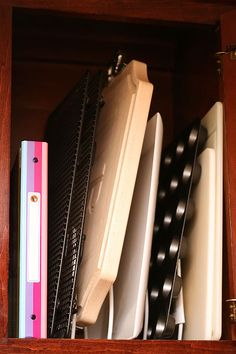 Kitchen Cabinet Organization-racks from WalMart. The notebook holds recipes printed off the internet!
