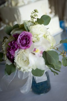 Beautiful floral bouquet to decorate your wedding cake table at your reception in the Hilton Pensacola Beach Gulf Front Hotel.