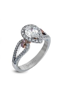 Pear Shaped Diamond Halo Engagement ring with pink diamond accent. Find Simon G Engagement ring at Trice Jewelers. Pear Shaped Engagement Rings, Halo Diamond Engagement Ring, Designer Engagement Rings, Pink Diamond Jewelry, Jewelry Rings, Fine Jewelry, Ring Watch, Pear Shaped Diamond, Jewelry Photography
