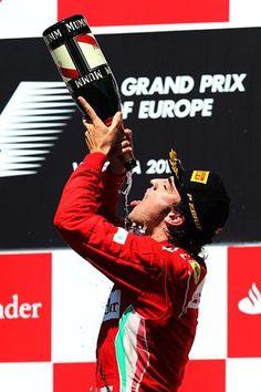 F1 European GP - Race winner Fernando Alonso (ESP) Ferrari celebrates on the podium with the champagne.  Formula One World Championship, Rd8, European Grand Prix, Race Day, Valencia, Spain, Sunday, 24 June 2012