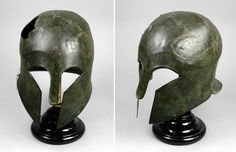 Ancient Greek Corinthian helmet in the Pitt Rivers museum, England. Pitt Rivers sent this object to Bethnal Green Museum for display, as part of the first batch of objects sent there, probably in 1874. This object was listed in the Delivery Catalogue as having been transferred from South Kensington Museum in 1884.