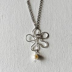 Made a silver wire plumeria necklace with a white freshwater pearl!