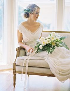 Edward Sofa beautifully complimenting this blushing bride - ready for event rental with Perch Event Decor - perchdecor.com