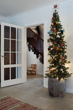 Christmas decorations are seen everywhere, from christmas ornaments, christmas trees to wreaths, Danish house for winter 2013 answered our questions about making entire room into christmas themed Tall Skinny Christmas Tree, Alpine Christmas Tree, Skinny Tree, Pencil Christmas Tree, Christmas Tree And Santa, Small Christmas Trees, Antique Christmas, Christmas Diy, Christmas Decorations
